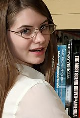 Nerdy flat-chested teen toying