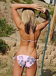 Flat-chested bikini blonde plays with the garden hose