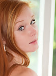 Freckled redhead teen masturbating