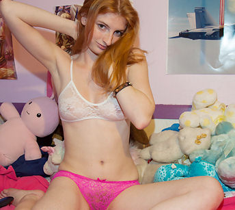 Hairy redhead in see-through panties