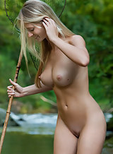 Busty blonde nude in a river