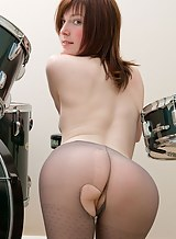 Fair-skinned redhead in pantyhose masturbating