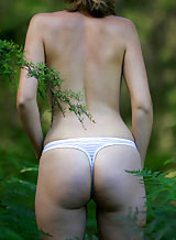 Sexy amateur in a thong in a forest