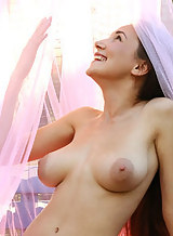 Busty brunette with big areolas nude in the garden
