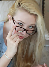 Nerdy blonde girl with pale skin stripping