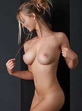 Sexy busty blonde posing nude