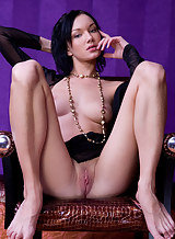 Black-haired hottie with big pussy lips stripping