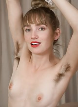 Very hairy blonde with pale skin in pantyhose