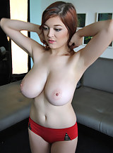 Redhead amateur shows off her huge tits