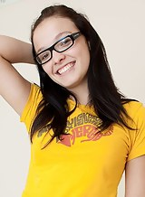 Geeky black-haired teen with glasses stripping