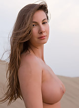 Busty brunette nude in sand dunes