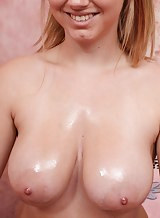 Shaved blonde with big natural tits toying