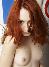 Redhead with pale skin posing nude