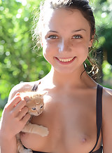 Freckled brunette teen having fun with kittens
