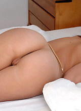 Busty brunette with tan lines nude in bed