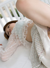 Japanese hottie Rina teases in panties and a see thru dress