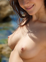 Sexy brunette babe nude at the beach