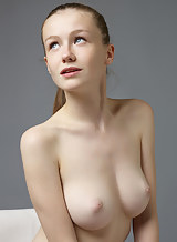 Young vixen Emily poses her perfectly gorgeous naked body