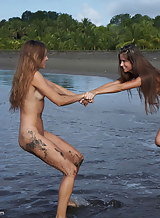 Brunette lesbians nude at the beach