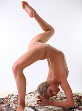 Flexible blonde posing nude