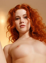 Redhead with firm tits Adel rubs her shaved pussy