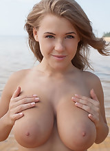 Busty hottie Viola Bailey shows off her big saucer areolas in a river