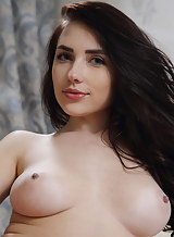 Busty black-haired hottie Niemira nude in bed