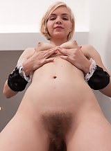Blonde girl spreads her hairy holes