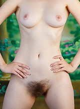 Sexy redhead spreads her hairy holes
