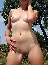Blonde lesbian Dido Angel toying her redhead friend outdoors