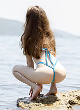 Brunette with pale skin masturbating at the beach