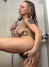 Busty hairy blonde masturbating in the shower