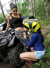 Horny lesbians licking each other on an ATV