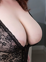 Chubby busty brunette with pale skin in black lingerie