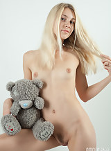 Flat-chested blonde teen posing with her teddy bear