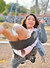 Flat-chested brunette teen squirting in a park