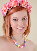 Cute redhead teen with blue eyes posing nude