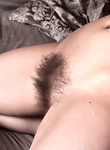 Hairy brunette amateur spreads her holes