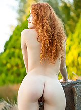 Sexy redhead Adel nude outdoors
