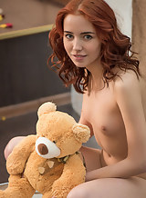 Shaved redhead with meaty pussy lips spreading