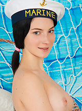 Hairy black-haired teen in a sailors hat