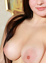 Chubby brunette with large areolas stripping