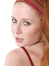 Freckled redhead pulls off her red dress