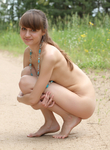 Brunette teen naked on a trail