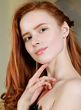 Flat-chested redhead spreads her inviting holes