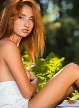 Freckled redhead Michelle nude in a forest