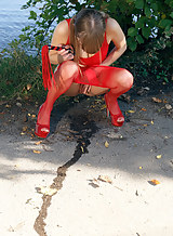 Sexy girl with a whip pissing outdoors