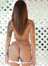 Tattooed brunette toying her shaved pussy