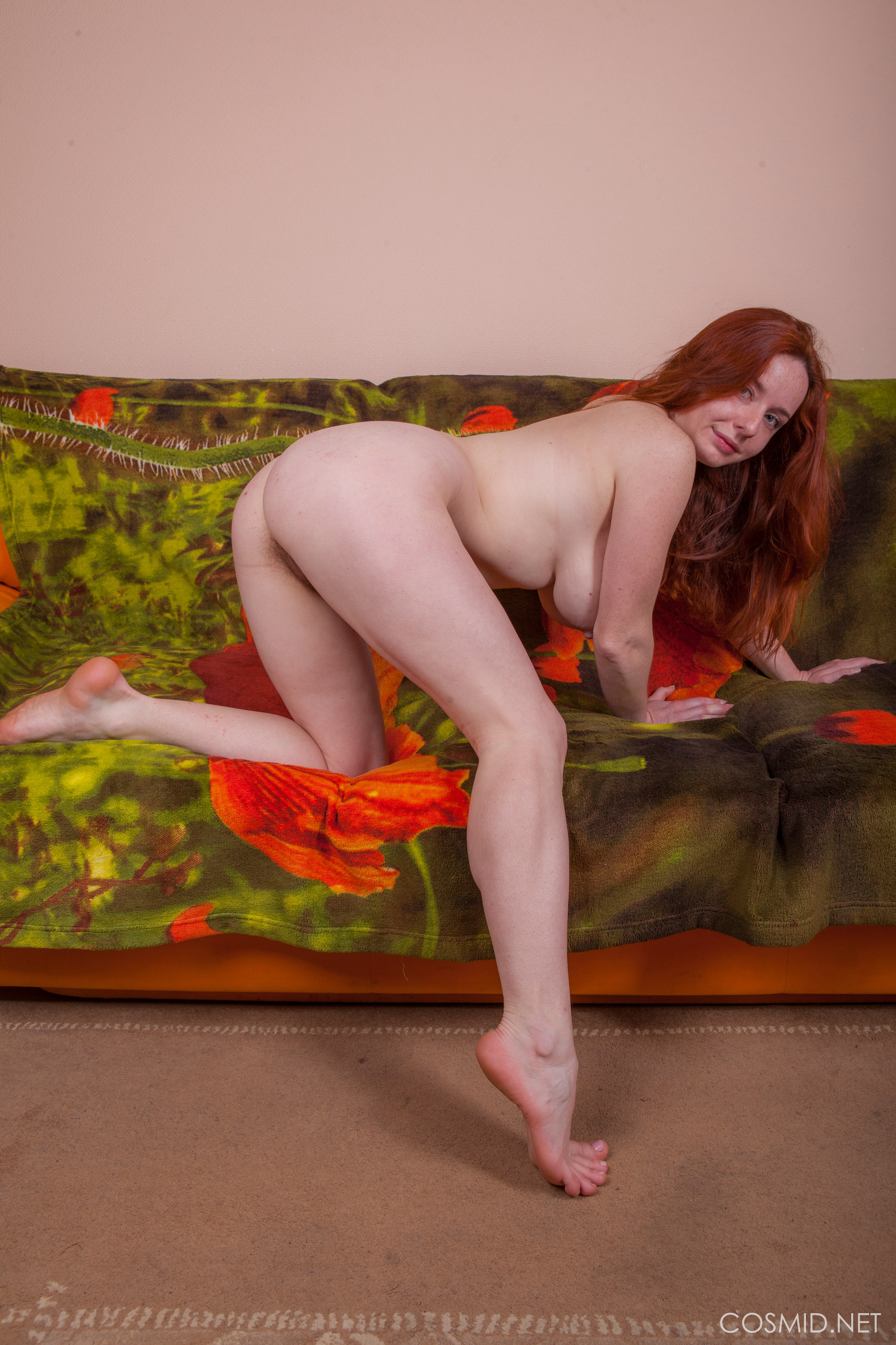 Freckled redhead with big tits shows off her hairy pussy ...